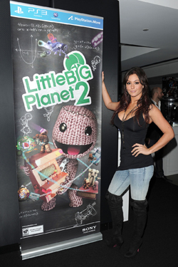JWoww posing with LittleBigPlanet 2